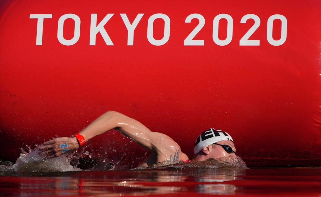 Aug 5, 2021; Tokyo, Japan; Florian Wellbrock (GER) competes in the men's 10km marathon swimming competition during the Tokyo 2020 Olympic Summer Games at Odaiba Marine Park. Mandatory Credit: Kareem Elgazzar-USA TODAY Sports