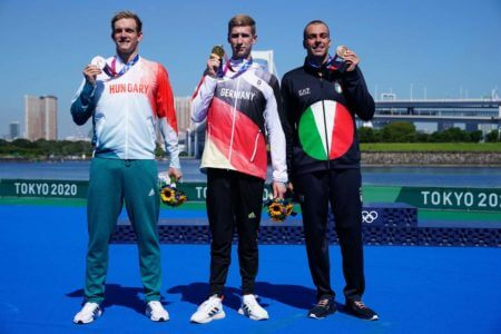 Aug 5, 2021; Tokyo, Japan; From left Kristof Rasovszky (HUN), Floridan Wellbrock (GER) and Gregorio Paltrinieri (ITA) on the podium after the men's 10km marathon swimming competition during the Tokyo 2020 Olympic Summer Games at Odaiba Marine Park. Mandatory Credit: Kareem Elgazzar-USA TODAY Sports