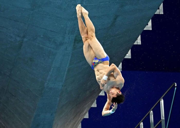 Aug 6, 2021; Tokyo, Japan; Yuan Cao (CHN) in the men's 10m platform preliminary round during the Tokyo 2020 Olympic Summer Games at Tokyo Aquatics Centre. Mandatory Credit: Rob Schumacher-USA TODAY Sports