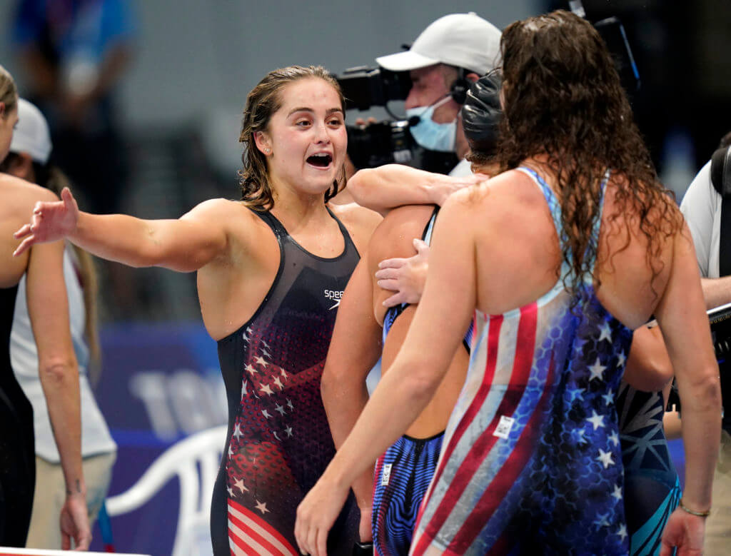 Jul 29, 2021; Tokyo, Japan; Katie McLaughlin (USA) reacts with her teammates after finishing second in the women's 4x200m freestyle relay during the Tokyo 2020 Olympic Summer Games at Tokyo Aquatics Centre. Mandatory Credit: Grace Hollars-USA TODAY Sports