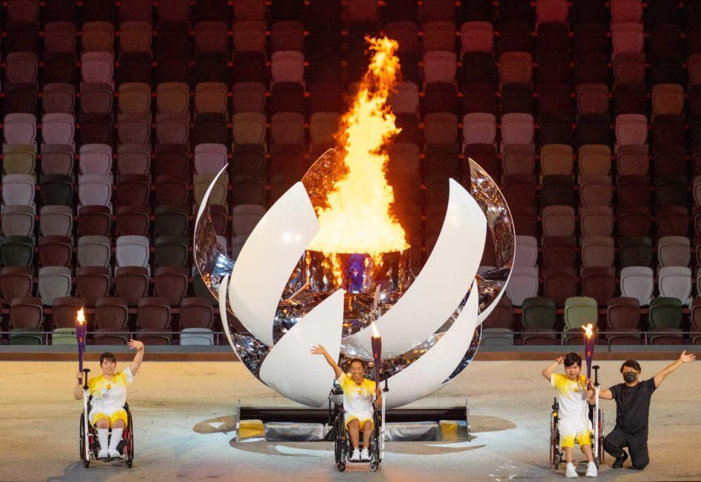 Aug 24, 2021; Tokyo, Japan; Torchbearers Yui Kamiji JPN (Wheelchair Tennis), Shunsuke Uchida JPN (Boccia) and Karin Morisaki (Paralympic Powerlifting) light the Paralympic flame in the Olympic Stadium during the Opening Ceremony for theTokyo 2020 Paralympic Games. Mandatory Credit: Bob Martin/OIS Handout Photo via USA TODAY Sports