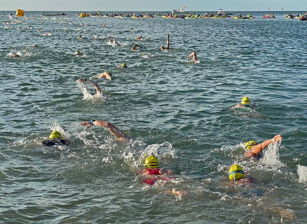 Competitors in the Swim for Alligator Lighthouse, an open-water, long-distance event, cross the start line Saturday, Sept. 11, 2021, in Islamorada, Fla., head to Alligator Reef Lighthouse, four miles off the Florida Keys. After rounding the lighthouse they swim back to shore. The event began in 2013 to help raise awareness to preserve the almost 150-year-old lighthouse as well as five other lighthouses off the Keys. This year's contest has attracted 461 swimmers. FOR EDITORIAL USE ONLY (Andy Newman/Florida Keys News Bureau/HO)